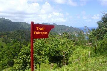 Wooden Trail Entrance Sign. Atlantic Ocean coastline, Dominica, Caribbean islands
