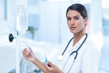 Nurse connecting an intravenous drip