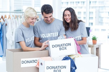 Volunteers friends checking a donation list