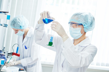 laboratory worker with flask