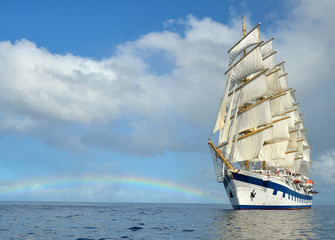 Sailing ship on the background of the rainbow