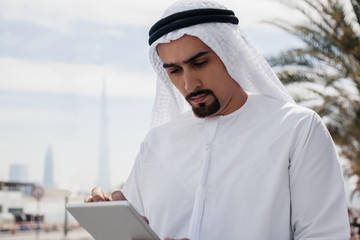 Arabian Businessman Using Digital Tablet