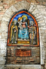 Outdoor fresco on wall of a medieval building in Perugia, Italy