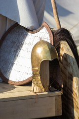 shield and helmet on wooden table