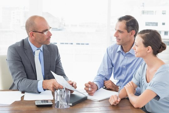 Businessman explaining contract to business partners