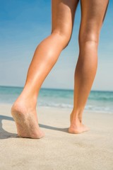 Feet of woman at the beach