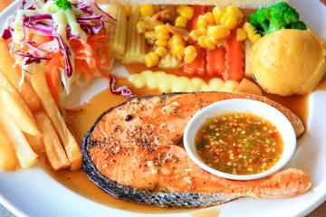 Salmon steak dinner with vegetable