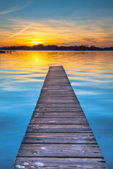Wall Mural - Sunset reflecting in the Tranquil Waters of Lake Paterswoldeseme