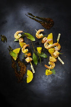 Food art, grill skewer with shrimps and salmon, red chili