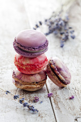 Four macarons and lavender on wood