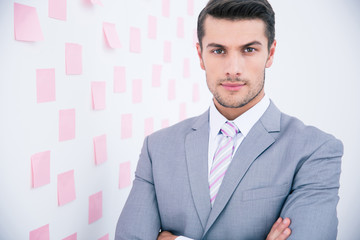 Handsome businessman standing in office