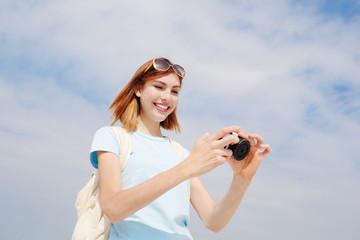 Happy travel woman use camera