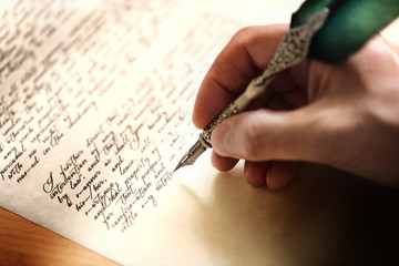 Writing with quill pen