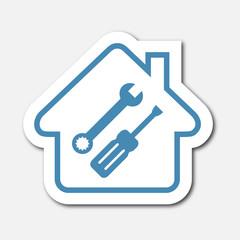 Logo maison et outils.