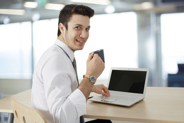 Businessman  working on laptop and drink coffee