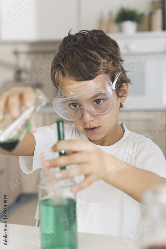 Boy playing science experiments at home