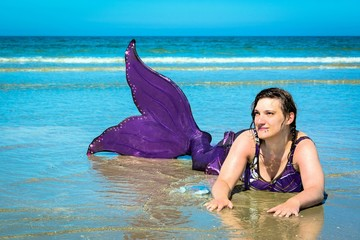 Meerjungfrau an der Küste