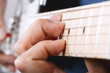Hands of man playing electric guitar