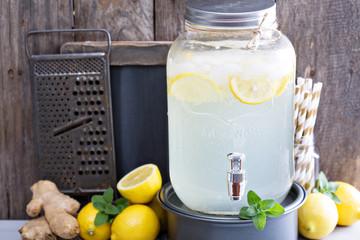 Ginger homemade lemonade in a beverage dispenser