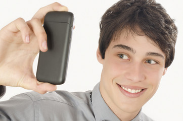 Happy businessman taking a selfie photo with his smart phone. Elegant man holding looking at his mobile phone.