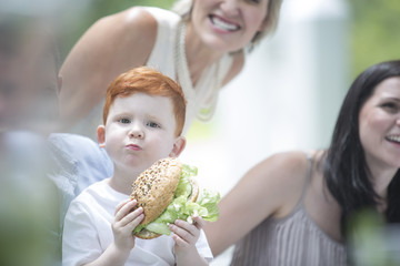 Red-haired boy at family gathering