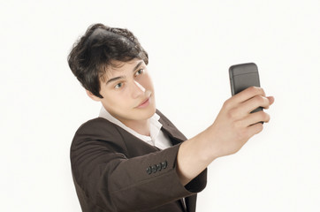 Happy businessman taking a selfie photo with his smart phone. Elegant man holding mobile phone.