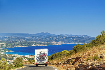 Caravan RV camper van on the road at the mediterranean shore