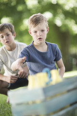Boys in garden playing quoits