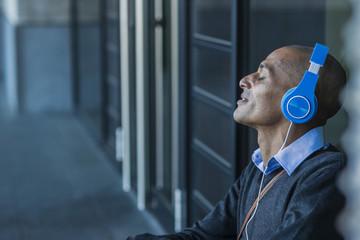 Man with closed eyes wearing headphones