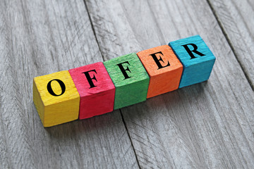 word offer on colorful wooden cubes