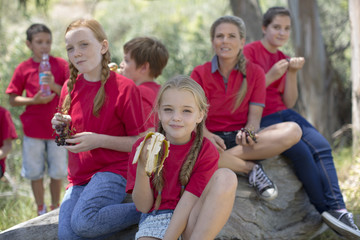 South Africa, Kids on field trip eating fruits for lunch