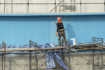 """painting facade builder worker """"movement"""" with roller at Water T"""
