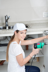 Plumber using the drill