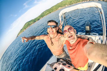 Adventurous best friends taking selfie at Giglio Island on boat