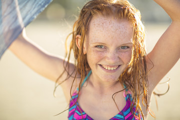 Portrait of smiling girl on the beach