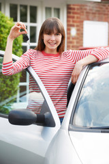Smiling Young Woman Holding Keys To First Car