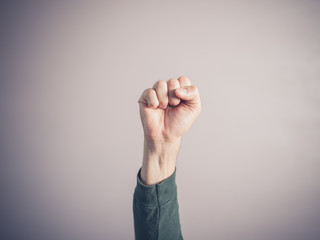 Clenched fist against purple background