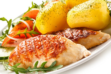 Grilled chicken fillets, boiled potatoes and vegetable salad