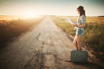Traveler girl looking map