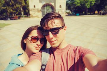 Tourist loving couple taking selfie