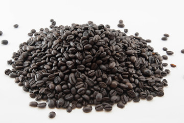 Roasted coffee beans, white background isolated