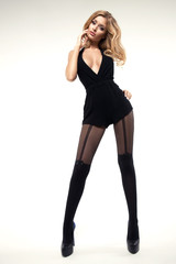 Sexy woman with long slim legs wearing tights