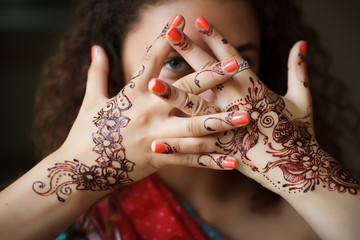 Hands with pattern of henna closeup