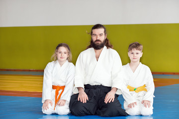 Children sitting on tatami with their Aikido instructor
