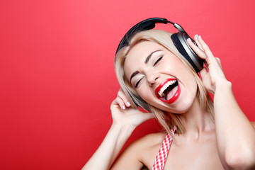 Young blond-haired woman with headphones