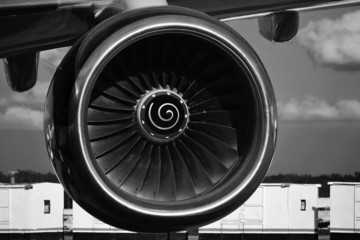 Turbine of airplane closeup under the wing, Boeing black & white at right