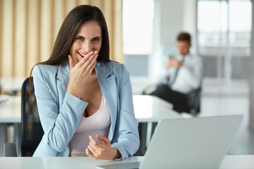 Business Woman Celebrates Something at her Workplace