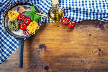 Italian and Mediterranean food ingredients on wooden backgroun