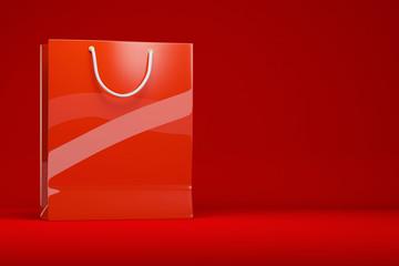 Rote Einkaufstasche vor Hintergrund