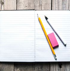 Blank notepad, pencil, pen and eraser